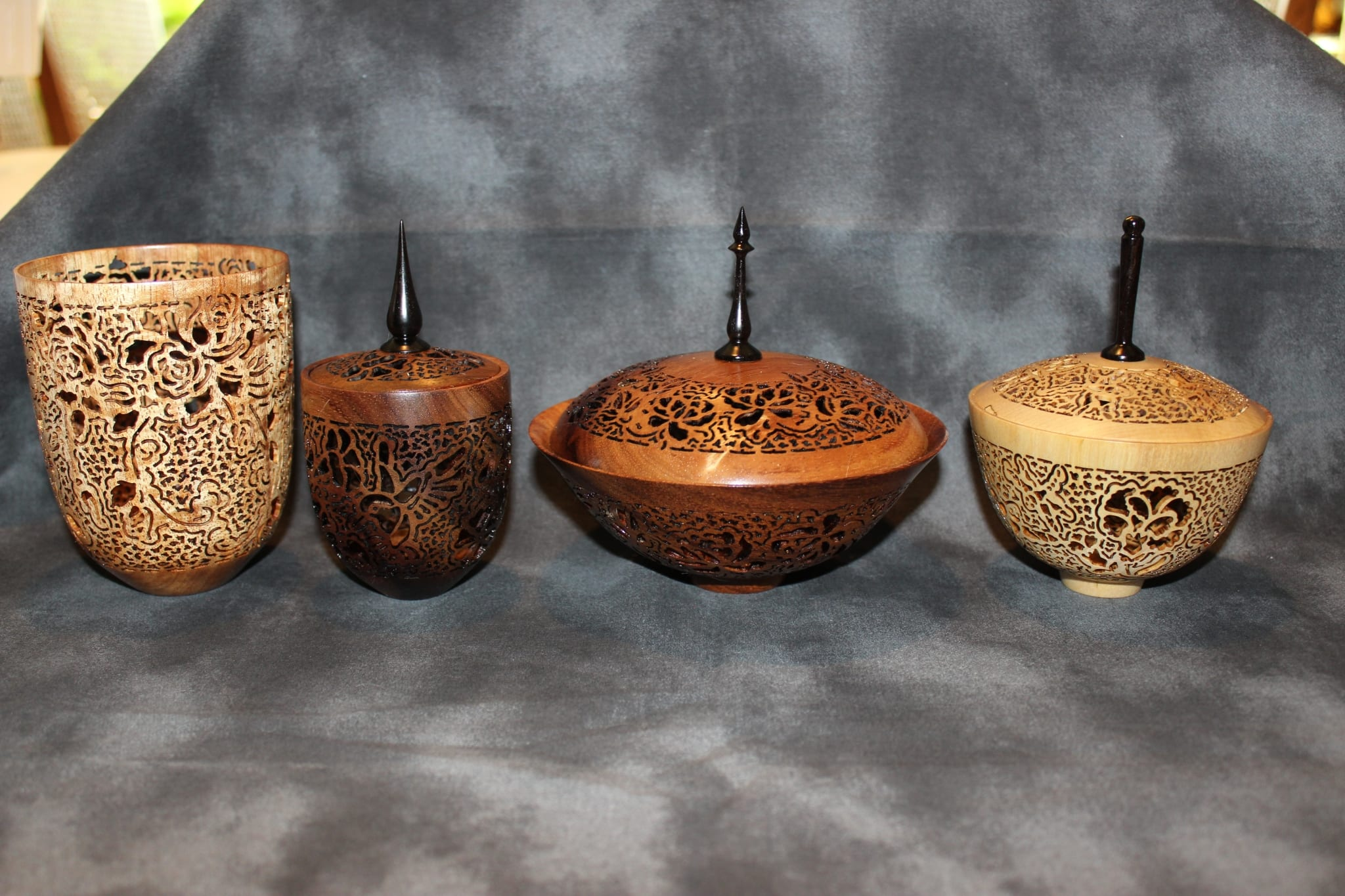 a selection of woodturning and wood piercing art by Pat and Peggy Bookey