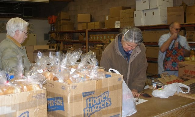 Laura Thorn, director of the Dayton Community Food Bank, keeps food and paperwork smoothly moving.