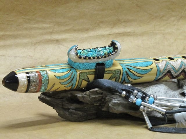 Detail from White Canoe hand carved flute by Wenaha Gallery guest artist Roger McGee