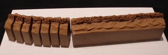 Individual bars from Walla Walla Soap Works start out as part of a long log, which itself is cut from a larger shape.