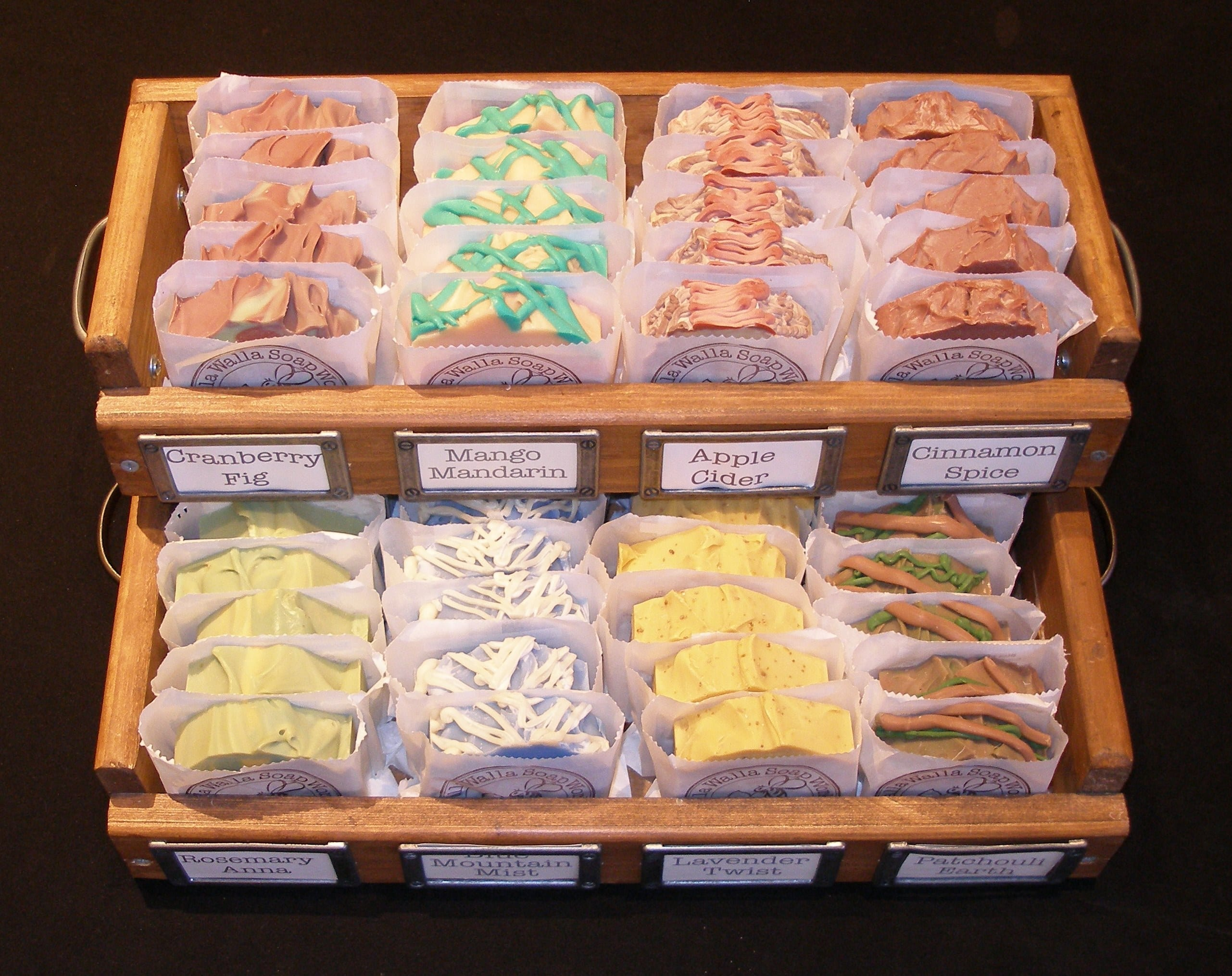 Large wooden trays hold and display the useful, usable soap sculptures of Walla Walla Soap Works