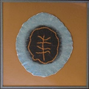 Framed felted wool art piece by fiber artist Sally Reichlin