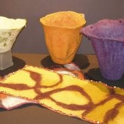 Felted wool vessels and table runners by Sally Reichlin of Olympia