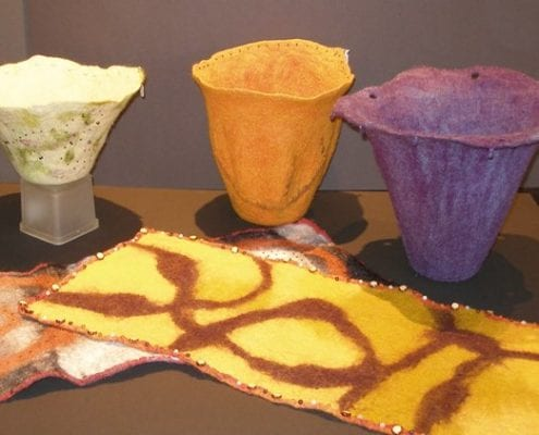 Felted wool vessels and table runners by fiber artist Sally Reichlin of Olympia