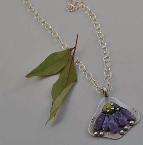 Torch-fired Coneflower necklace by Lynn Gardner, guest artist at Wenaha Gallery
