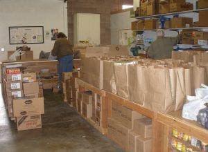 Bags of food at the Dayton Community Food Bank await weekly distribution