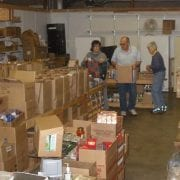 Dayton Community Food Bank volunteers sort through boxes of food donations