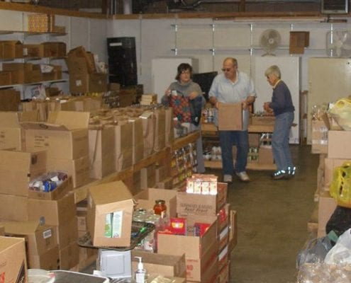Dayton Community Food Bank volunteers sort through boxes of food donations