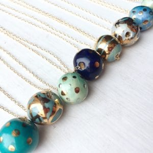 ceramic and gold bead necklaces in blue and green by Jane Holly Estrada