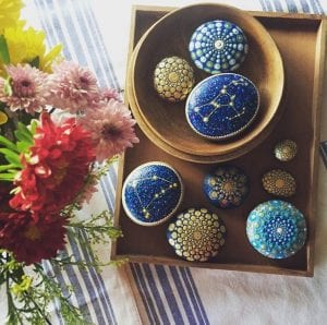 A collection of painted rocks and mandala stones by jane holly estrada