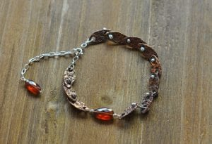 Bracelet incorporating bronze and hessonite nuggets by Rachelle Moore