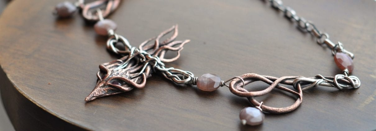 Bronze, silver, ruby, and moonstone necklace by Rachelle Moore, guest artist at Wenaha Gallery